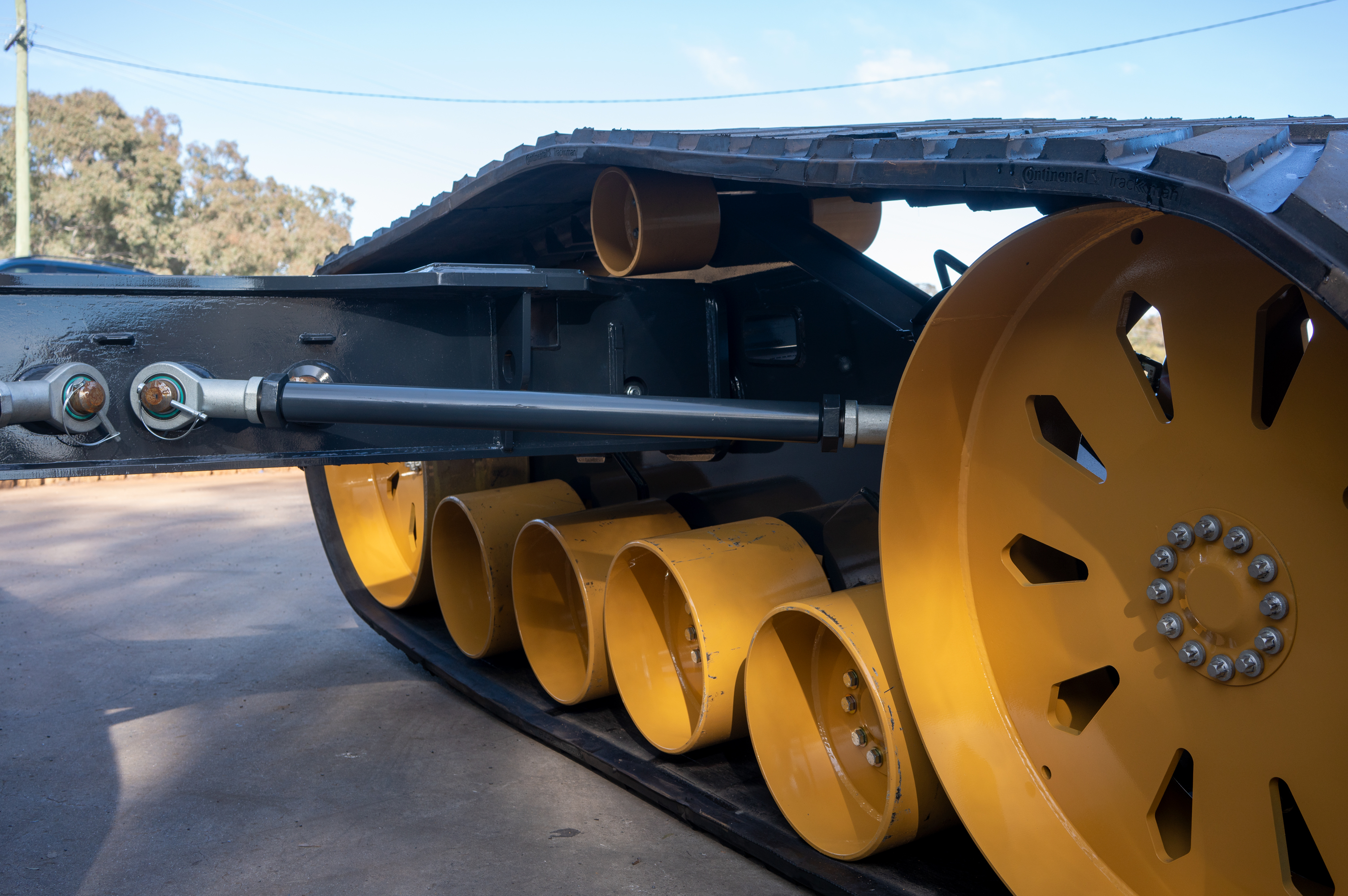 rear of track undercarriage chaser bin